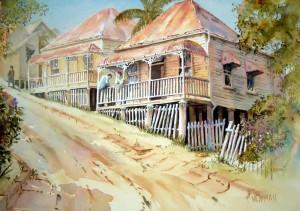 Two weathered old Queenslanders in Petrie, an inner suburb of Bribane in Queensland